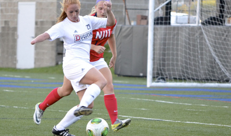 Women's soccer rolls on