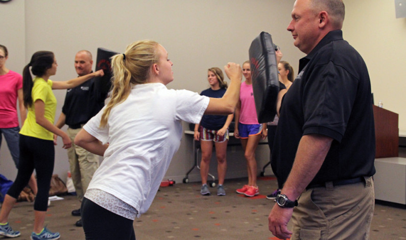 Women learn how to defend themselves in the Power Center