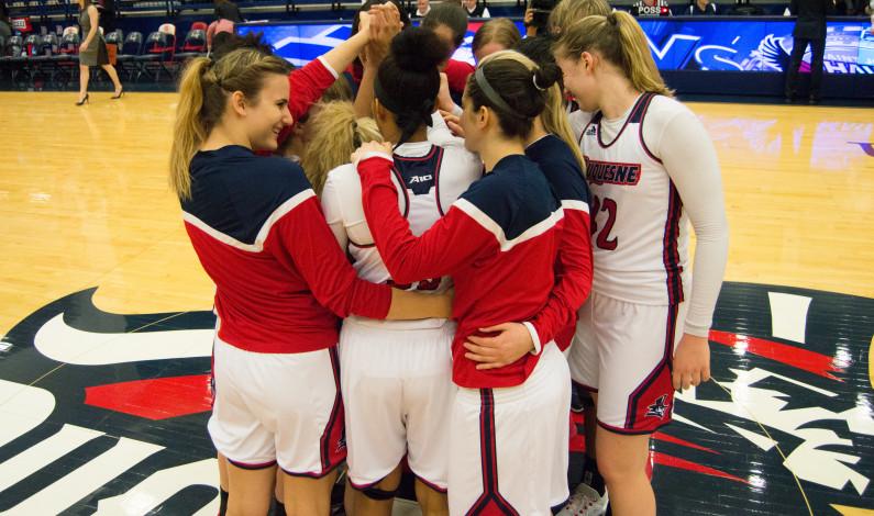 Women's hoops tops Rhode Island 61-56 for 22nd win
