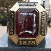 DU ring statue in sticky situation after letter 'D' falls off
