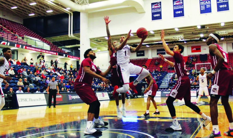 Lewis II powers Duquesne past UMass with 31 points