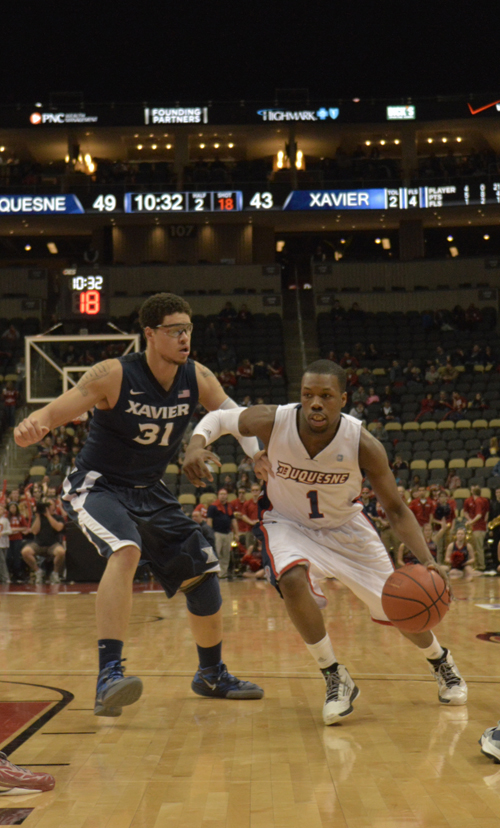 Connor Hancovsky / For The Duquesne Duke | Derrick Colter dribbles the ball and prepares to pass for the Dukes in their 73-65 loss to Xavier on Saturday at the Consol Energy Center.