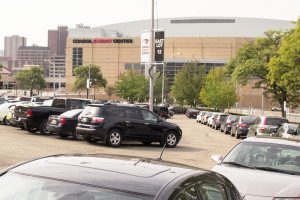 Photo by Aaron Warnick | Photo Editor. Cars are parked in the lot where the Civic Arena used to stand, in plain sight of the Pittsburgh Penguins' current home, Consol Energy Center.