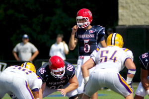 Freshman quarterback Dillon Buechel makes his pre-snap reads Saturday against Albany. He was named co-Rookie of the Week of the Northeast Conference in his starting debut.