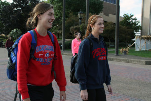 Photo by Claire Murray | The Duquesne Duke. Freshmen Jorden Thornton (left) and Ashley Gault (right) sport Duquesne shirts on Academic Walk. The SGA and athletic department are starting a campaign to increase school pride, which will include a t-shirt exchange.