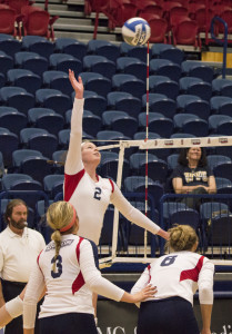 Connor Hancovsky | Multimedia Editor  Freshman outside hitter Madelynn Burnham prepares to defend the ball. The Duquesne volleyball team handed WVU their first loss of the season.