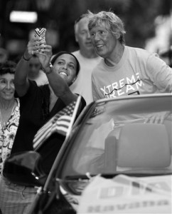Endurance swimmer Diana Nyad, right, views a fan's cellphone phone photo Tuesday, during a parade in Key West, Fla., a day after Nyad completed a Cuba-to-Key West swim that took over 52 hours.