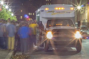 By Aaron Warnick | Photo Editor. Dozens of Duquesne students cram into the loop bus on Saturday night. On Friday and Saturday nights, students can board a shuttle to South Side, Oakland or Waterfront for free with an student ID and runs until after midnight.
