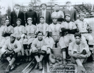 Photo courtesy of The Carnegie Library of Pittsburgh. The 1913 Homestead Grays pose for a team photo. Cumberland Posey, the third man from the left in the second row, was the team's captain and manager.