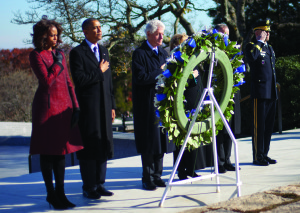 AP Photo. President Barack Obama, first lady Michelle Obama, former President Bill Clinton and his wife former Secretary of State Hillary Rodham Clinton, pause during a wreath laying ceremony in honor of President John F. Kennedy on Nov. 20.