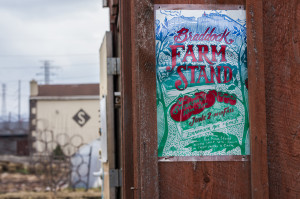 Aaron Warnick / Photo Editor - A sign for the Braddock Farm Stand, where produce from Braddock Farms is sold to residents.