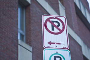 Photo by Aaron Warnick | Photo Editor. A no parking sign on Forbes Avenue symbolizes the fate of city officials' passes.