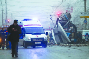 AP Photo. An ambulance leaves the site of an explosion on Dec. 30 after a bomb blast tore through a trolley in the city of Volgograd.