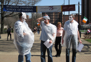 Courtesy of Duquesne American Chemical Society - Chemistry and Biochemistry professors Jeffry Madura, Jeffery Evanseck and Ralph Wheeler getting pied at last year's Pi Day.