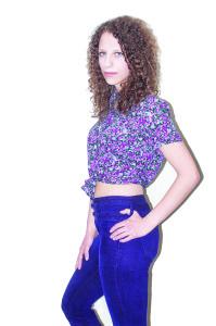 ( Aaron Warnick / Photo Editor) - Model Avi Diamond, senior music therapy major, poses for fashion photos.
