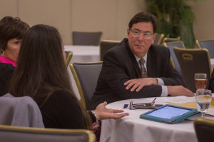 Photo by Aaron Warnick | Photo Editor. Pittsburgh Mayor Bill Peduto talks to advocates of education reform in the Power Center Ballroom on Wednesday. The mayor gave the closing remarks.
