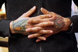 (Katie Auwaerter / The Duquesne Duke)- The hand tattoos of Travis Courtemanche