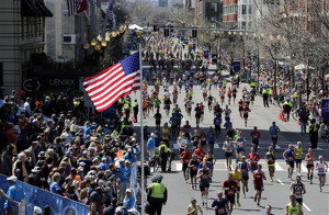 AP Photo. Runners head to the finish line in the 118th Boston Marathon Monday in Boston.
