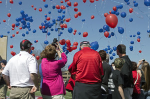 Photo by Julian Routh | News Editor. Family of Ryan Fleming, the Duquesne sophomore business student who died in January, watch as the balloons they released moments earlier float into the sky.