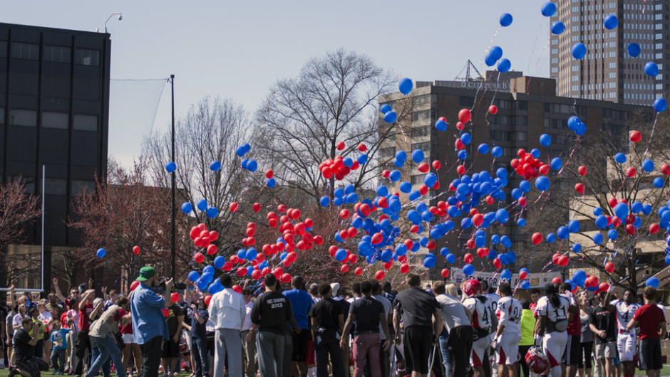 Photo by Richard Kresock | For The Duquesne Duke. Dozens gather Saturday afternoon on Rooney Field to release balloons in memory of Ryan Fleming, who died this January.