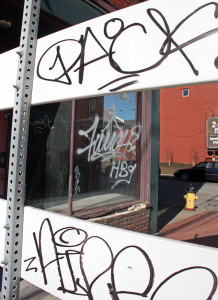 Photo by Claire Murray   Asst. Photo Editor. Graffiti lines the exterior of a storefront on East Carson Street in South Side.