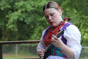 (Claire Murray / Photo Editor) - Junior Krista Gush practices her tambura before a performance.