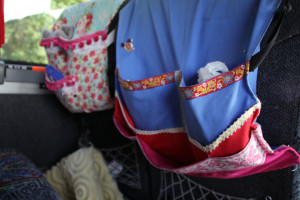 (Claire Murray / Photo Editor) - Each Tamburitzan has a personal pouch hanging in front of their seat on the bus.