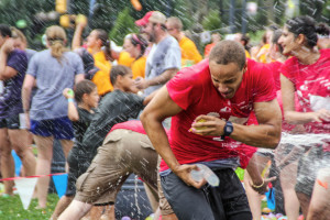 A participant gets caught in the line of fire during the Great American Water Balloon Fight on Saturday. The event benefits the non-profit organization Team Tassy, which fights global poverty.