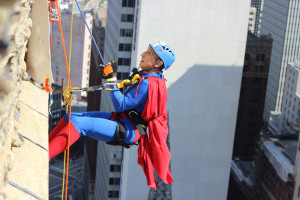 Photo by Fred Blauth | Editor-in-Chief. Pittsburgher Bert Dorazio rappels down the Oliver Building Wednesday morning in a Superman costume.