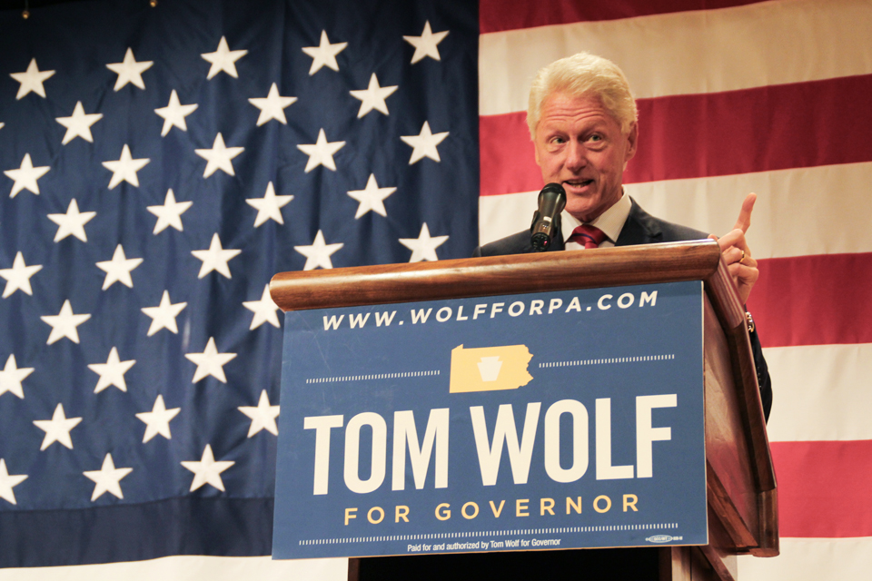 Photo by Zach Brendza | Features Editor. Former President Bill Clinton praises Democratic gubernatorial candidate Tom Wolf at a campaign event Monday at the IBEW Union Hall in South Side. Clinton urged voters to unseat Republican incumbent Tom Corbett in the election Nov. 4.