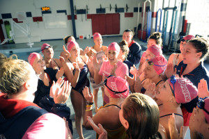 Courtesy of Athletic Department The women's swimming team cheers in a huddle at the Towers Pool earlier this season.