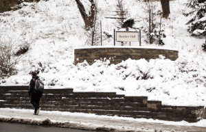 Photo by Claire Murray | Photo Editor. A student walks past Brottier Hall on Tuesday afternoon after Pittsburgh was hit with a storm that dumped more than five inches of snow on the region.