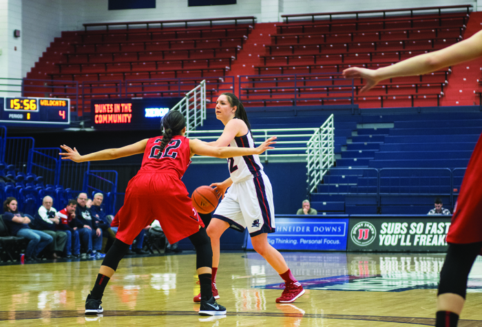 Claire Murray / Photo Editor Senior guard Olivia Bresnahan looks to swing the ball around the wing during Saturday's game against Davidson. She finished with 10 points, five rebounds, four assists and two steals.