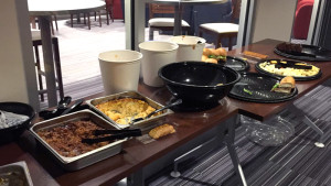 (Kaye Burnet/The Duquesne Duke) A spread of food is laid out in the Nitespot for Super Bowl viewers to feast on.