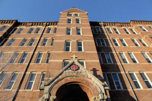 Photo by Taylor Miles   The Duquesne Duke. Old Main, which houses Duquesne's administrative staff, towers over campus.