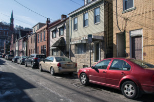 Photo by Claire Murray | Photo Editor. Cars line 14th Street in South Side where Duquesne students live off campus.