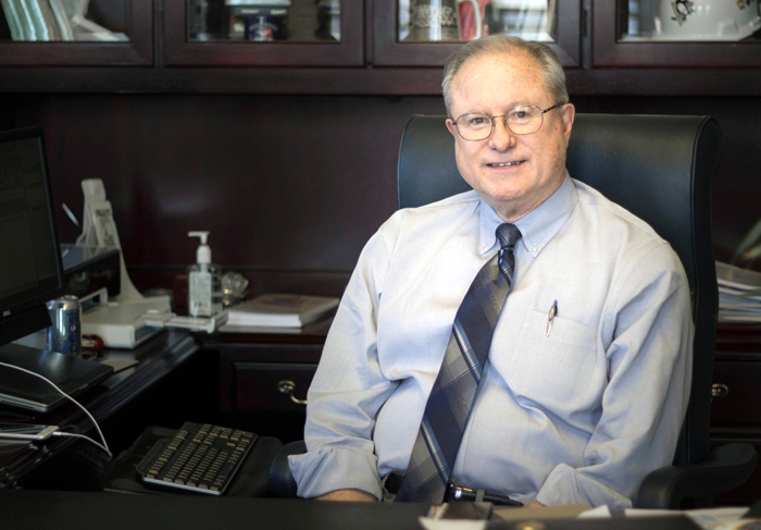 Photo by Claire Murray | Photo Editor. University President Charles Dougherty poses for a photo Monday in his office in the Administration Building. The 65 year-old announced last week that he will step down from his post on June 30, 2016, citing term limits and family as his reasons.