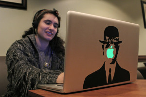 Photo by Taylor Miles | The Duquesne Duke. Sophomore music therapy major Elizabeth Harris surfs the internet on the campus wireless network, which has recently come under fire for its lack of effectiveness.