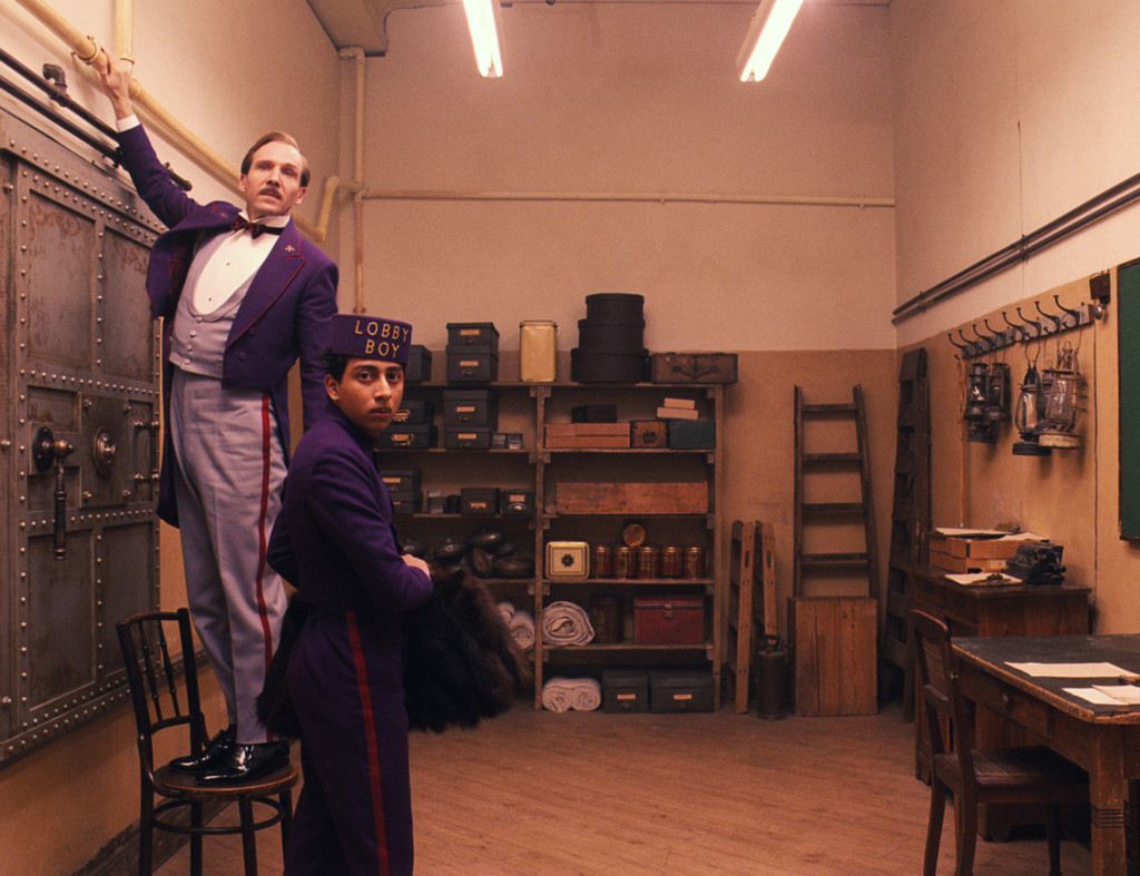 "This image released by Fox Searchlight shows Ralph Fiennes, left, and Tony Revolori in ""The Grand Budapest Hotel. "" The film is nominated for an Oscar Award for best feature. The 87th Annual Academy Awards will take place on Sunday, Feb. 22, 2015 at the Dolby Theatre in Los Angeles. (AP Photo/Fox Searchlight)"