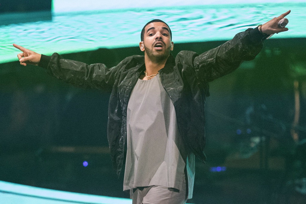 "FILE - In this Oct. 24, 2013 file photo, Drake performs during his ""Would You Like A Tour"" show in Toronto. The Toronto-based rapper, singer and actor will host the July 16, 2014, ESPYs sports awards show on ESPN in Los Angeles. The Grammy-winning rapper gave $75,000 for a recording studio at Strawberry Mansion High School in Philadelphia. (AP Photo/The Canadian Press, Chris Young, file)"