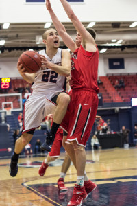 Fred Blauth / The Duquesne Duke Junior guard Micah Mason draws a foul in the second half of the Dukes' 107-78 loss to Davidson. Mason finished with 17 points, six rebounds and four assists.