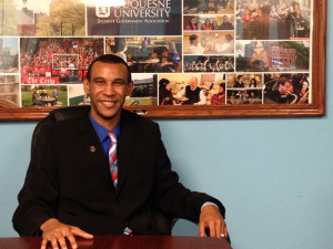 Photo by Kaye Burnet | The Duquesne Duke. Incoming President John Foster smiles for a photo in the Student Government Association office. Foster and his executive board will officially take office Sunday.