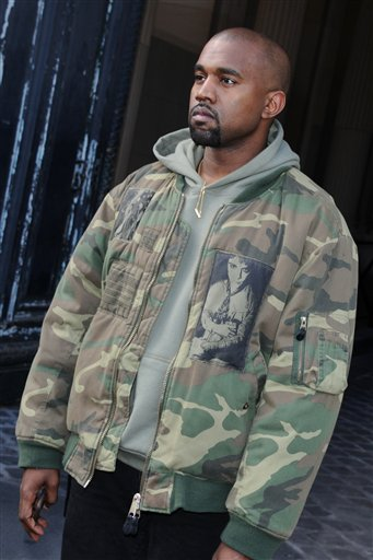 Kanye West poses as he arrives to attend Dries van Noten's Fall Winter 2015 /2016 Ready to wear fashion collection as part of Paris Fashion Week in Paris, France, Wednesday, March 4, 2015. (AP Photo/Binta)