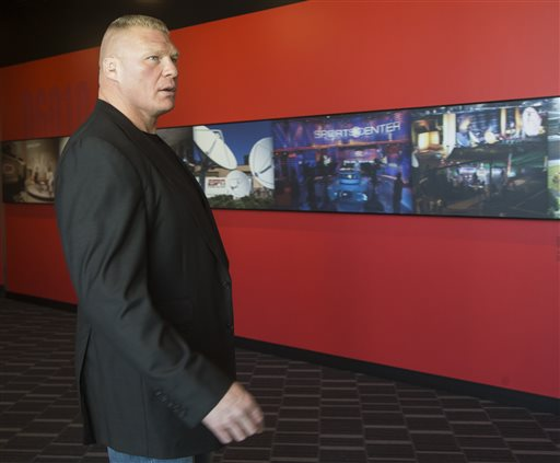 "Former UFC heavyweight champion Brock Lesnar pauses for a photo after ruling out a return to mixed martial arts, ending three years of speculation about the biggest pay-per-view star in the sport's history, as he announced he had re-signed with WWE in an interview on ESPN's ""SportsCenter,"" in Los Angeles on Tuesday, March 24, 2015. Lesnar tells The Associated Press he was in training for a UFC return as recently as last week despite his conflicted feelings about it. He finally decided to stick with professional wrestling only in the past two days. (AP Photo/Damian Dovarganes)"
