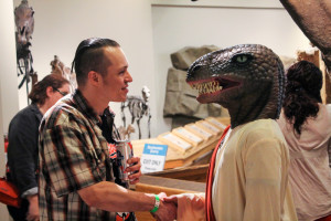 Fred Blauth/Photo Editor - A member of the After Dark community featured in a dinosaur mask.