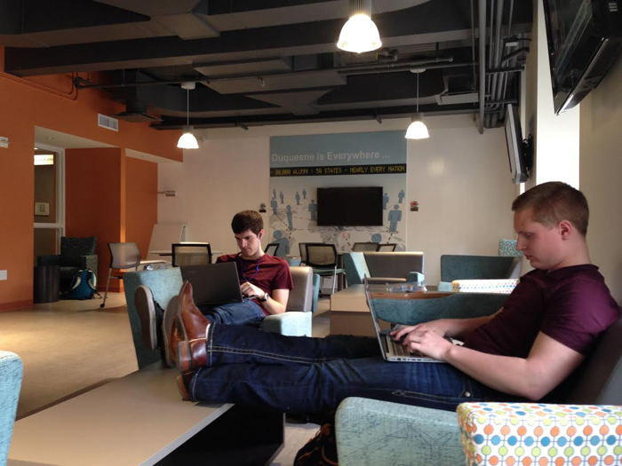 Kaye Burnet | Asst. News Editor. Duquesne sophomores Eric Herrmann (left) and Ryan Kuchnicki take a break between classes April 15 in Rockwell Hall's newly renovated 5th floor lounge.
