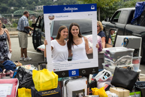 Photo by Claire Murray | Photo Editor. Two incoming freshmen pose for a photo inside a makeshift Instagram frame Tuesday on Bluff Street. The Office of Residence Life staff – which posted the photos on Instagram – helped move in the fifth-largest class in university history.