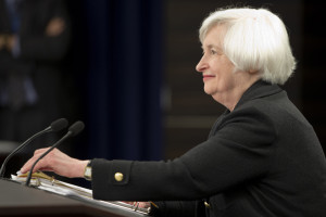 Federal Reserve Chair Janet Yellen smiles as she takes her seat at a news conference in Washington, Thursday, Sept. 17, 2015. The Federal Reserve is keeping U.S. interest rates at record lows in the face of threats from a weak global economy, persistently low inflation, and unstable financial markets. (AP Photo/Jacquelyn Martin)