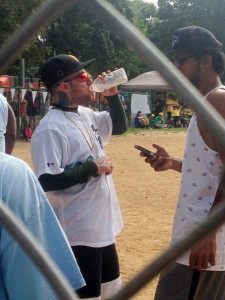 Photo by Julian Routh | Editor-in-Chief. Mac Miller drinks from a Gatorade bottle in between innings during a softball tournament at Arsenal Field on Saturday. Mac wore his high school's colors.