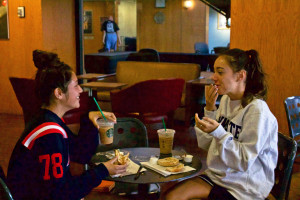 Photo by Emma Vescio | The Duquesne Duke Two Duquesne students sit down for coffee at Starbucks. A new study shows that drinking coffee late at night can alter the way the body keeps track of time.